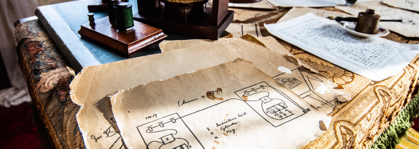 Old papers on desk inside a historic home