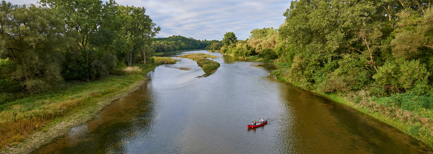 Two people in a canoe paddle the Grand River.